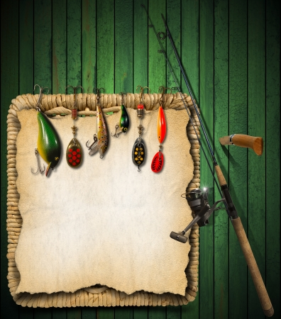 baits: Green wooden background with fishing tackle, knife and wicker basket