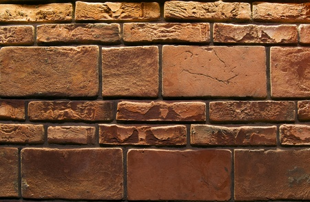 Wall for background texture with damaged brown bricks photo