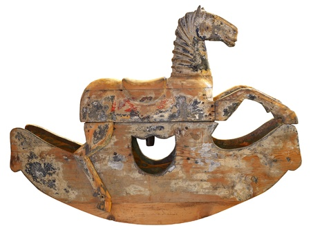 Old brown wooden rocking horse isolated on white background photo
