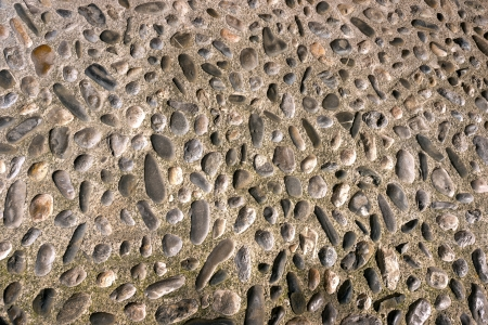 Conglomerate of assorted irregular pebbles in cement, floor or background Stock Photo - 22659882
