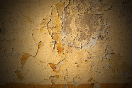 Old orange wall with cracked paint, vintage dirty wall photo
