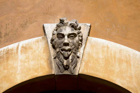grotesque: Ancient keystone with grotesque mask in Verona Italy  Europe