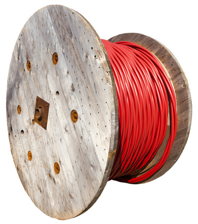 Wooden huge coils of red high-voltage power cable on white background photo
