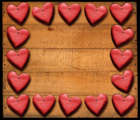 Many wooden red hearts on wooden damaged boards with nails photo