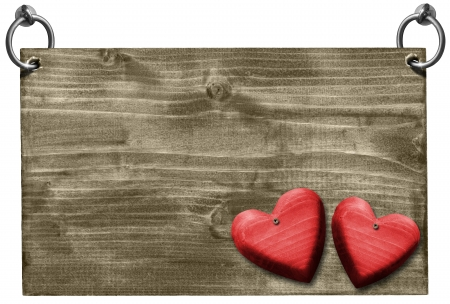 Empty wooden signboard hanging on to two steel ring with two wooden red hearts  photo