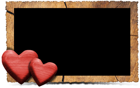 Rectangular empty wooden frame with two red wooden hearts isolated on white photo