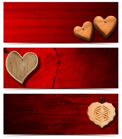 Handmade wooden hearts hanging on red wooden background - Three banners  photo