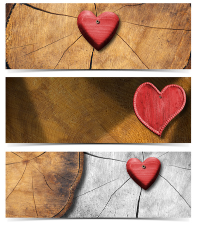 Handmade wooden hearts hanging on trunk section background - Three banners  photo