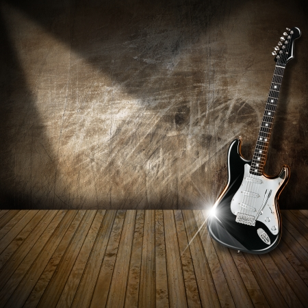 古い放棄されたインテリアの黒と白のエレク トリック ギター