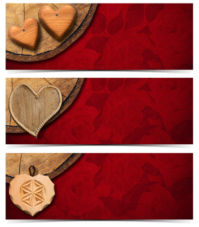 Handmade wooden hearts hanging from a section of tree trunk on red velvet with roses flowers  photo