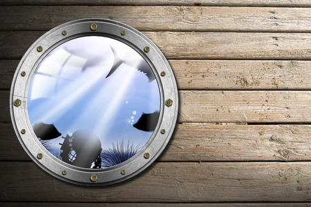metallic seaweed: Metallic porthole with bolts and blue sea abyss landscape on wooden floor with sand Stock Photo