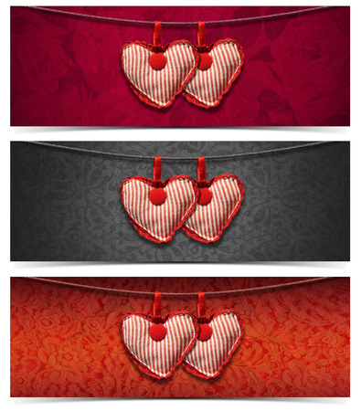 Two handmade red and white cloth hearts hanging on a steel cable on fabric background  photo