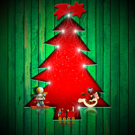 Green wooden wall with a hole in the shape of stylized christmas tree decorated with Christmas objects  photo