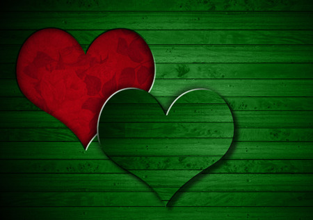 Green wooden wall with a hole in the shape of heart and red velvet background with roses flowers photo