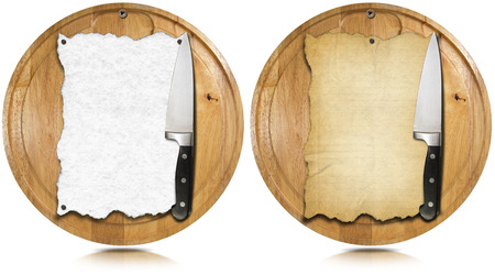 Two notebooks for recipes or menu on used wooden cutting boards and kitchen knife photo
