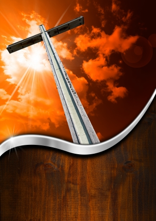 Wooden high cross with red and orange sky, clouds and rays and wood background photo