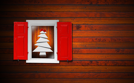 White stylized Christmas tree seen through a wooden window with red shutters  photo