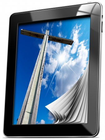 Tablet computer with pages and monitor with wooden high cross with blue sky, clouds and reflection  photo