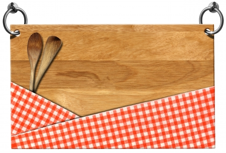 ladles: Cutting board with red checked tablecloth and two wooden spoons or ladles hanging on to two steel ring isolated on white