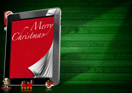 Tablet computer with pages, Christmas objects with red velvet and word Marry Christmas on green wooden wall  photo