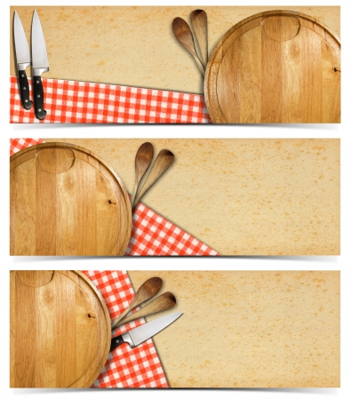Cooking banners with round cutting board, red checked tablecloth on yellowed paper, kitchen knife and wooden spoons isolated on white   photo