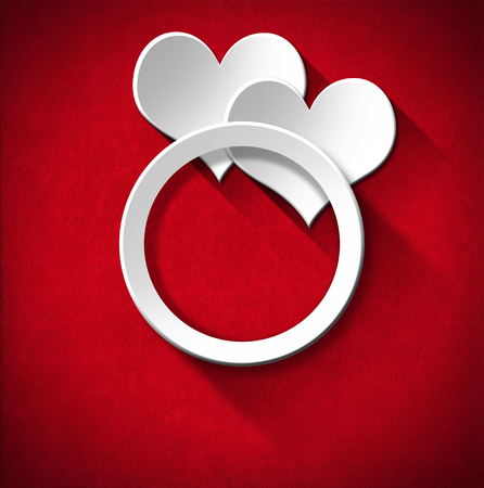 Two stylized white hearts and wedding ring on red velvet background with shadows photo
