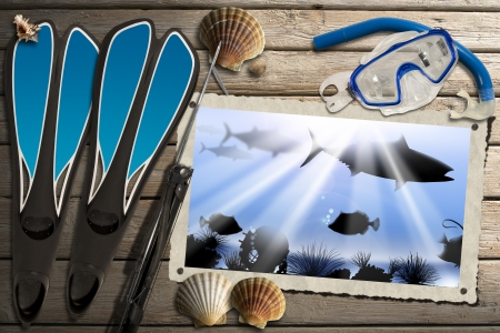 speargun: Aged photo frame with sea abyss landscape on wooden floor with sand, seashells, flippers, snorkel and mask for diving and spear gun