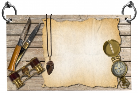 wooden signboard: Wooden signboard hanging on to two steel rings with compass, folding knives, binoculars, flint and empty parchment