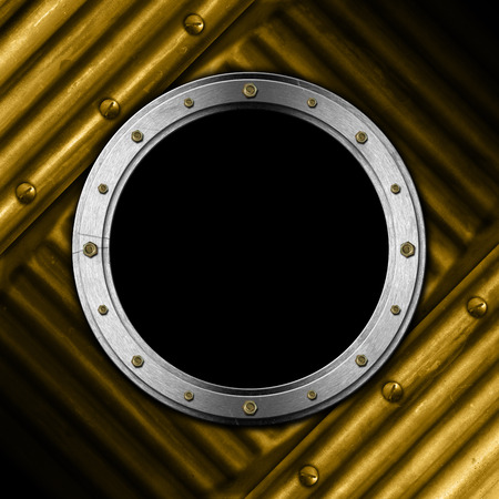 Metallic porthole with bolts on a golden metal background with screws photo