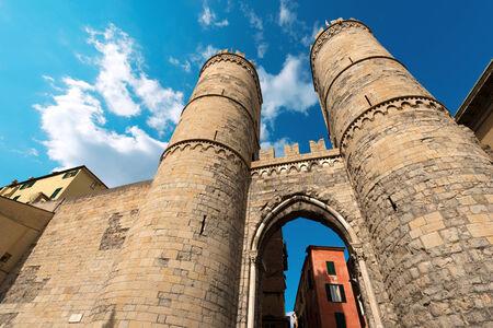 crenelation: Ancient  Porta Soprana  or  Urbica  of St  Andrea - XII century in Genova, Liguria, Italy