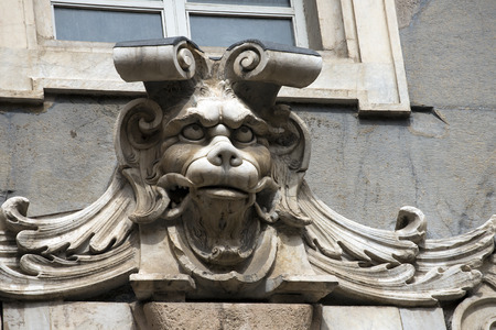 grotesque: Ancient grotesque stone mask on the facade of the building Tursi  Palazzo Tursi  in Genova, Liguria - Italy