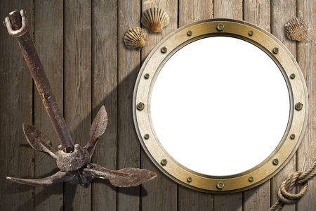 seafaring: Metal empty porthole with seashells and old rusty anchor on a wooden floor with sand