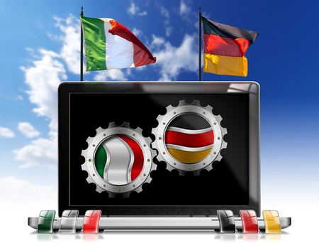 Two metallic gears with italian and german flags in the monitor of a laptop computer on a blue sky with clouds photo