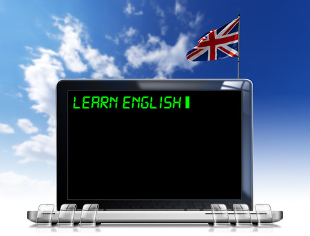 Modern laptop with black screen and word  learn english  on display and british flag on a blue sky photo