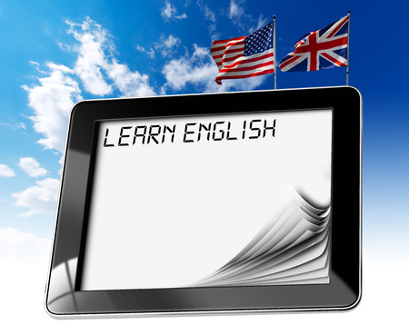 Black tablet computer with pages and phrase  learn english  on display, british and usa flags on a blue sky photo