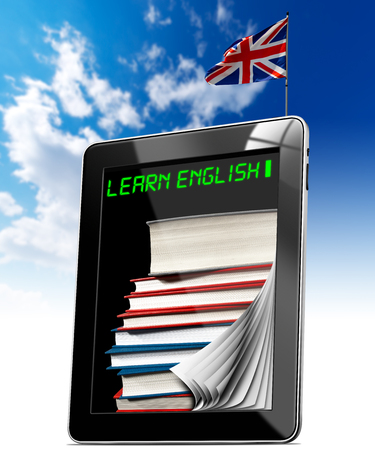 Black tablet computer with pages, phrase  learn english  and stack of books on display, UK flag on a blue sky photo
