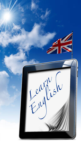 Black tablet computer with pages and word  learn english  on display and british flag on a blue sky photo