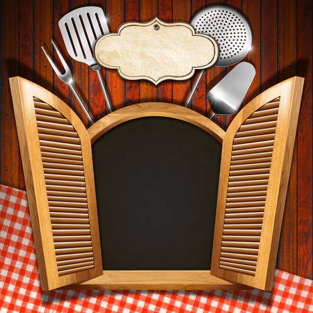 Wooden window (inside black) with open shutters, kitchen utensils and empty label on wooden wall with red and white tablecloth photo