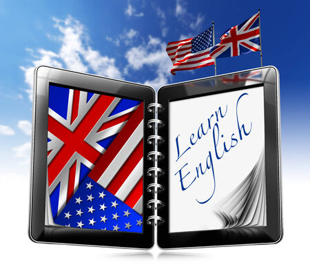 Black tablet computer with two pages and phrase  learn english  on display, UK and US flags on a blue sky photo