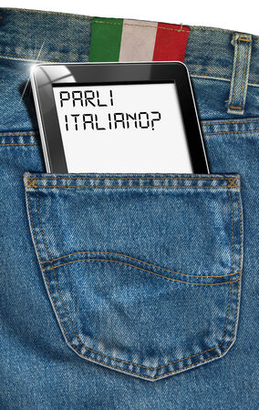 Jeans with black tablet computer with phrase  Parli Italiano   in a pocket and label with flag of Italy - concept to speak Italian everywhere photo