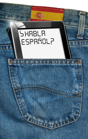 pocket pc: Jeans with black tablet computer with phrase  Habla Español   in a pocket and label with flag of Spain - concept to speak Spanish everywhere