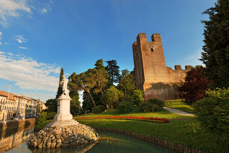 treviso: Old walls of Castelfranco Veneto and Giorgione statue, northeast side  XII-XIII century  in the province of Treviso, north Italy
