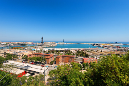 Spain, Barcelona cityscape with the port and the sea, aerial view seen from Montjuic hill  photo