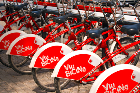 shared sharing: BARCELONA, SPAIN - JUN 10, 2014  Bicycle of the Bicing service in Barcelona sponsored by Vodafone  With the bicing sharing service people can rent bicycles for short trips