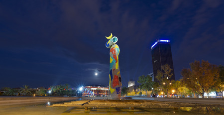 BARCELONA, SPAIN - JUN 12, 2014  Dona i Ocell  Woman and Bird  of Joan Miro  1893-1983  realized by ‪Joan Gardy Artigas‬  1983  at night in the Park Joan Miro  In the background the Bullring Arenas