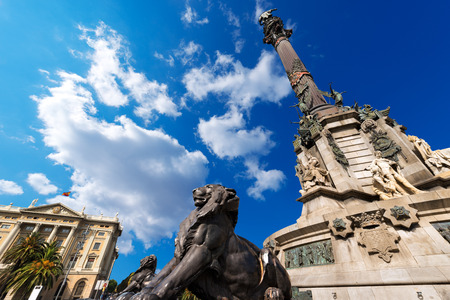 Column of Barcelona, Spain, monument dedicated to the famous Italian navigator Cristorofo Colombo  On the left the building of the military government
