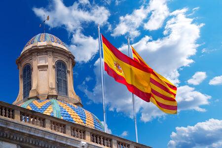 generalitat: Detail of Palau de la generalitat de Catalunya in Barcelona, Spain with Spanish and Catalan flag waving in the wind Stock Photo