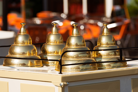 Close up of a italian ice cream cart with three lids golden pyramid shaped photo