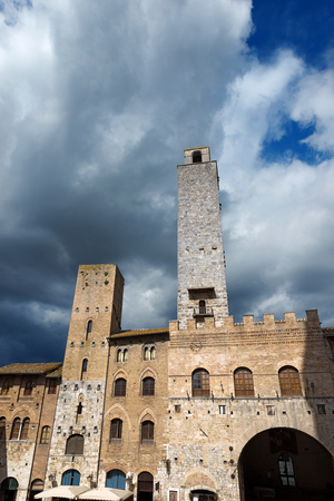 heritage protection: Buildings and towers in Piazza del Duomo, San Gimignano medieval town  UNESCO heritage , Siena, Tuscany, Italy