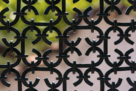 Silhouette of an old wrought iron fence painted with black color photo